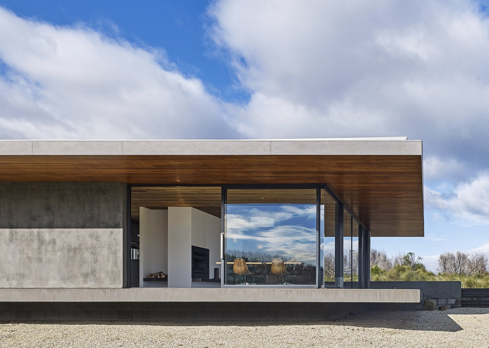 Exterior, House Building Type, Concrete Siding Material, and Flat RoofLine The living area floats atop a deeply recessed steel-reinforced concrete block structure.  Tasmania, Australia Dwell Magazine : September / October 2017  Best Photos from A Semi-Modular Beach House in Tasmania Floats Over a Site That Survived a Bushfire