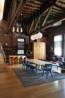 The second-story loft, formerly home to owner Nick Lloyd and his wife, artist and professor Megan Craig, now provides a living area, a kitchen, and two bedrooms for traveling musicians. - New Haven, Connecticut Dwell Magazine : September / October 2017