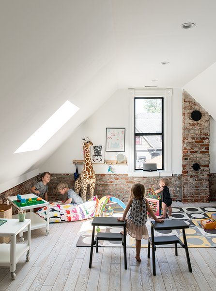 The second floor houses the children's bedrooms and a sunny playroom. The wood floors throughout are prefinished distressed white oak. - Denver, Colorado Dwell Magazine : September / October 2017