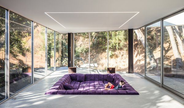 This Cupertino home features a conversation pit outfitted with a 250-square-foot configuration of Patricia Urquiola's Tufty-Time sofa for B&B Italia. Overhead, flush-mounted LED strips demarcate the lounge area. - Cupertino, California Dwell Magazine : September / October 2017