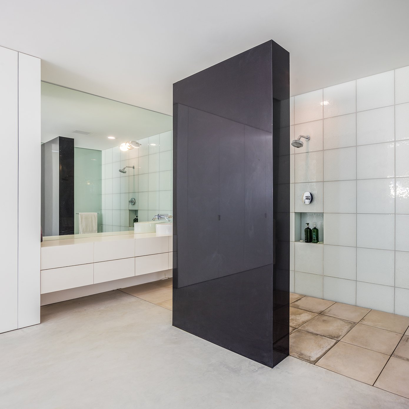 Bath Room, Open Shower, Full Shower, and Vessel Sink The master suite features a monolithic wall of quartz to separate the shower from the rest of the room. - Cupertino, California Dwell Magazine : September / October 2017  bains from The Conversation Pit Makes a Much-Appreciated Comeback at an Ultramodern Home in Cupertino