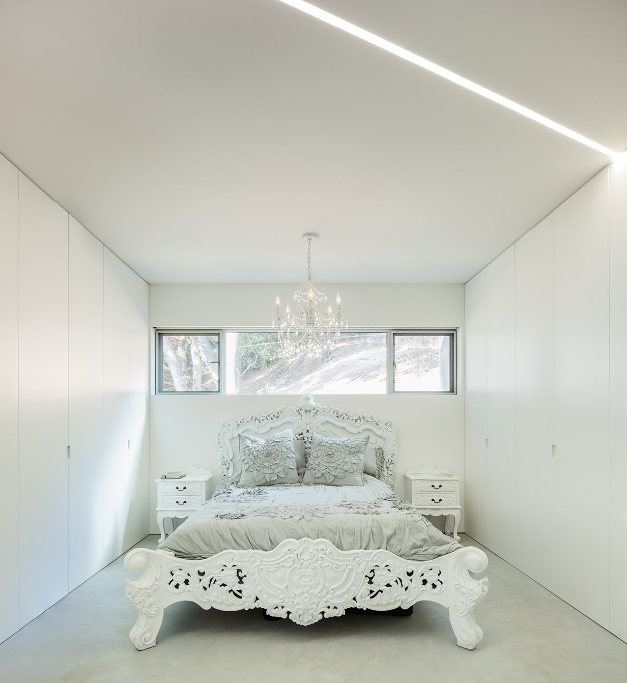 Bedroom, Bed, Night Stands, and Pendant Lighting Ornate furnishings in the bedrooms offer an intriguing contrast to the rest of the house. - Cupertino, California Dwell Magazine : September / October 2017  Photo 9 of 10 in The Conversation Pit Makes a Much-Appreciated Comeback at an Ultramodern Home in Cupertino