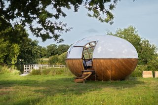 Based on the travels of a beloved French naturalist, Mr. Plocq's Caballon is an egg-shaped cabin that takes cues from both naval and aircraft carpentry.