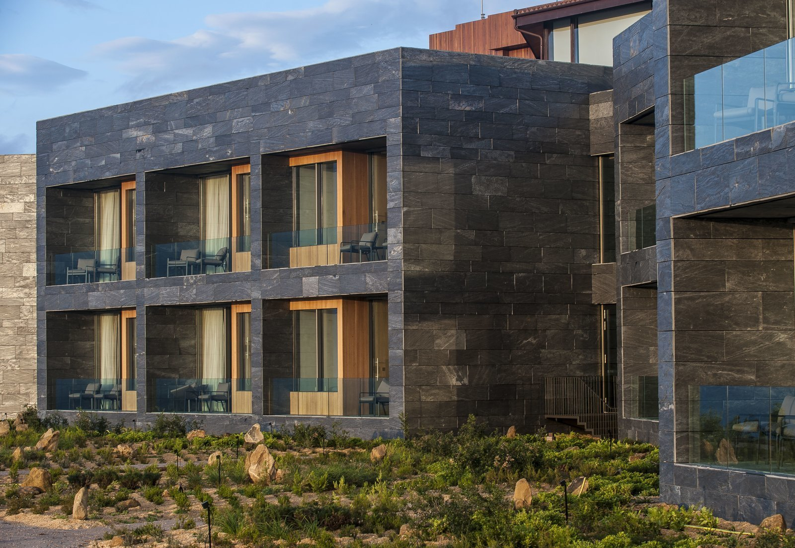 Exterior, Stone Siding Material, and Flat RoofLine View of the guest room terraces from the exterior.  Photo 2 of 13 in Spain's Basque Coast Gets a New Modern Hotel With a Michelin-Starred Restaurant