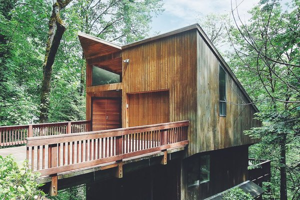 Though the tree house-inspired home is nestled in the middle of a dense forest, it's still only 10 minutes away from downtown Portland.