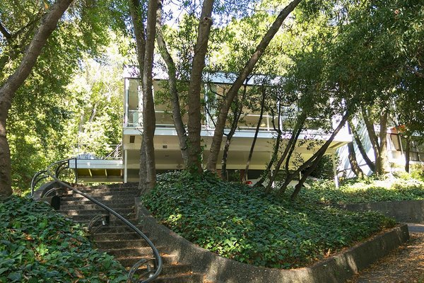 The home gracefully sits among the surrounding canopy of trees.