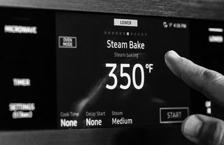 The Dacor Wi-Fi-enabled seven-inch LCD Touchscreen puts cutting-edge kitchen technology at your fingertips.