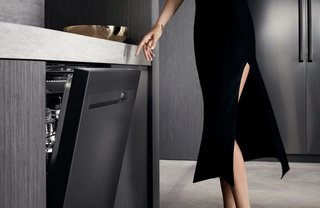 Sleek but also spacious, the Dacor Modernist Dishwasher can hold up to fourteen place settings and features innovative WaterWall and ZoneBooster technologies to make sure that every piece comes out spotless.