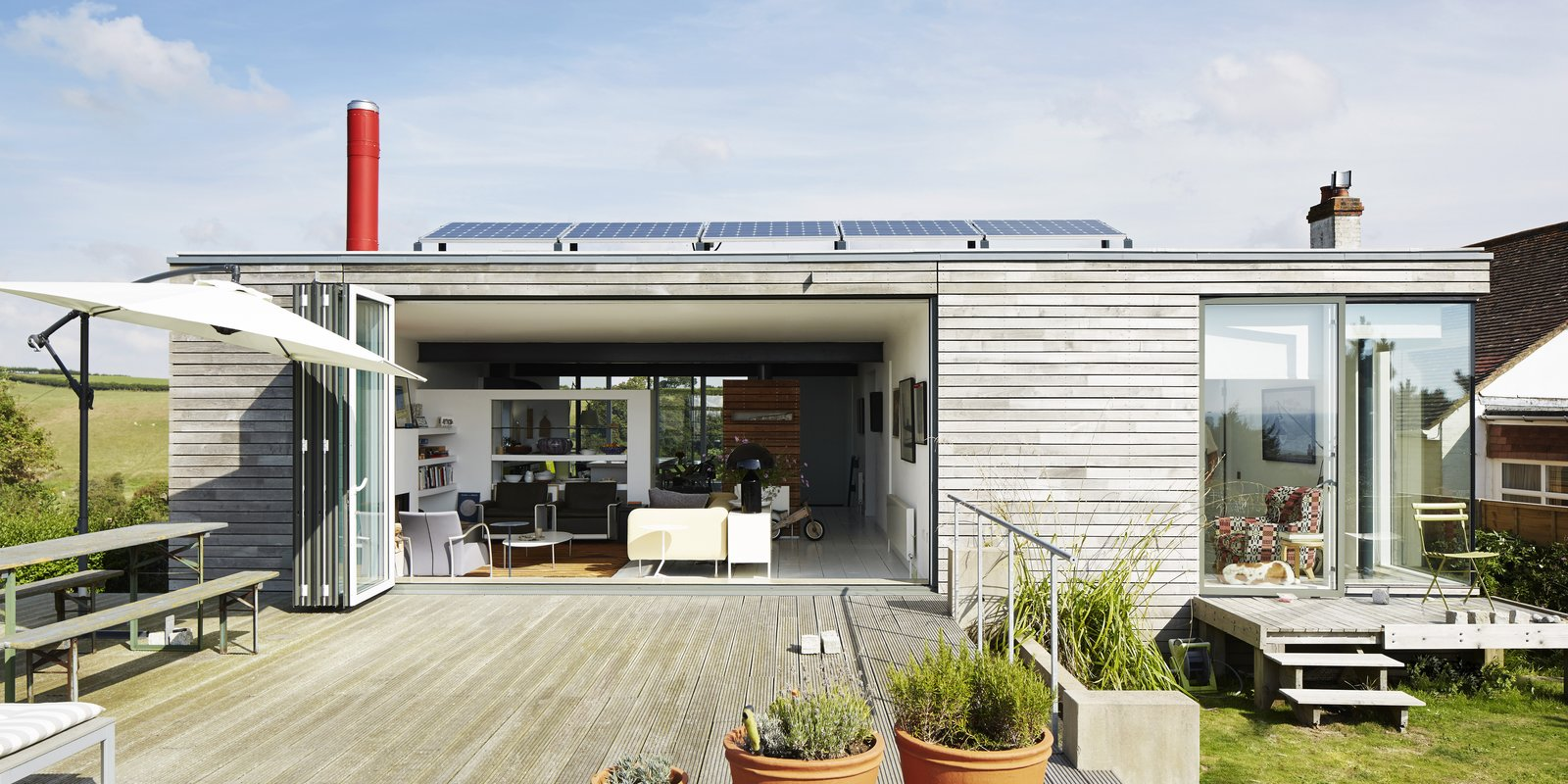 Outdoor, Wood Patio, Porch, Deck, Raised Planters, and Grass Pett Level, England Dwell Magazine : November / December 2017  Photo 1 of 14 in Fall in Love With This British Architect's Colorful Weekend Retreat