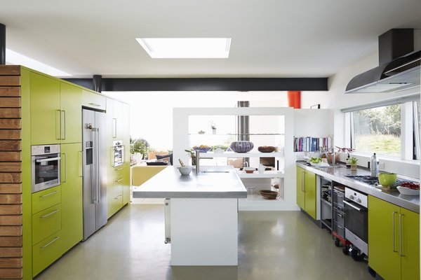 Eye-popping color is used sparingly in Nick Evans and Celia Sellschop's house, but with great effect—not least in the brilliant green kitchen that sits at the home's center. Celia is a chef in London and runs a supper club, so space for culinary experimentation was an essential part of Nick's self-imposed brief. This is the first home he has designed for himself, and he's glad he didn't do it earlier in his career.