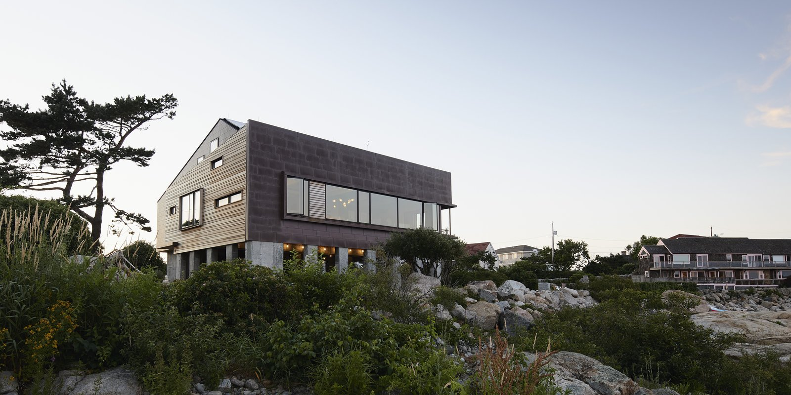 Exterior, Wood Siding Material, Metal Siding Material, and Prefab Building Type - Rockport, Massachusetts Dwell Magazine : November / December 2017  Photo 3 of 10 in Dwell's Top 10 Prefabs of 2017 from On the Coast of Massachusetts, a Prefab Ranch Is Totally Overhauled for a Wheelchair User