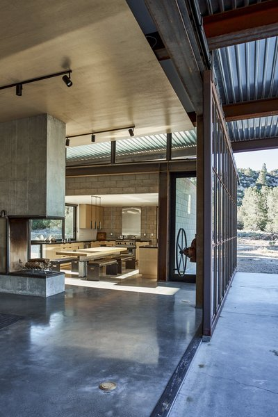"Working with owner Bruce Shafer, who acted as contractor, architect Olson Kundig's ""gizmolo- gist"" Phil Turner fashioned a 12-by- 26-foot steel-framed window wall that opens the structure to the out- doors. ""We can feel the evening breeze move through the house, - Tehachapi Mountains, California Dwell Magazine : November / December 2017"