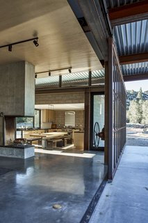 """Working with owner Bruce Shafer, who acted as contractor, architect Olson Kundig's """"gizmolo- gist"""" Phil Turner fashioned a 12-by- 26-foot steel-framed window wall that opens the structure to the out- doors. """"We can feel the evening breeze move through the house, - Tehachapi Mountains, California Dwell Magazine : November / December 2017"""
