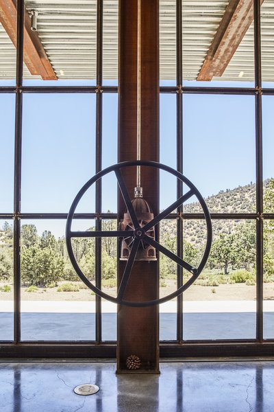 A gearbox from an old irrigation pump helps turn the wheel that opens the window wall, a detail that reflects Kundig's love of simple yet sophisticated - Tehachapi Mountains, California Dwell Magazine : November / December 2017