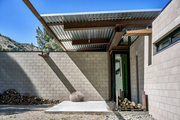 """The couple requested low-maintenance materials. Says Carol, """"We don't want to paint on weekends—we want to enjoy the place."""" - Tehachapi Mountains, California Dwell Magazine : November / December 2017"""