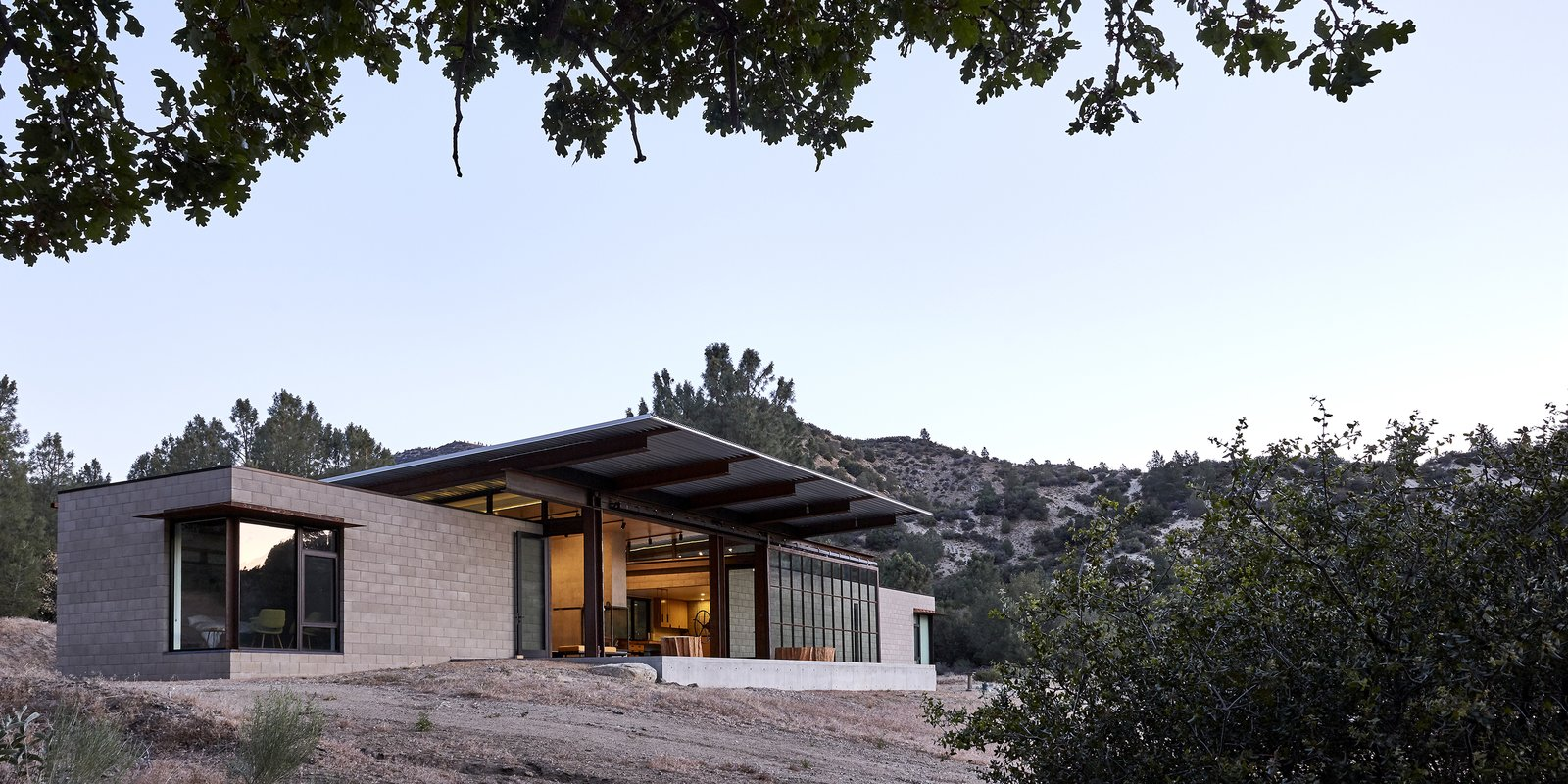Exterior, House Building Type, and Concrete Siding Material - Tehachapi Mountains, California Dwell Magazine : November / December 2017  Best Photos from At This High-Desert Home, a Whole Wall Opens Up When You Crank a Giant Wheel