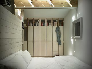 The bed sits atop a platform; above it is an HVAC vent.