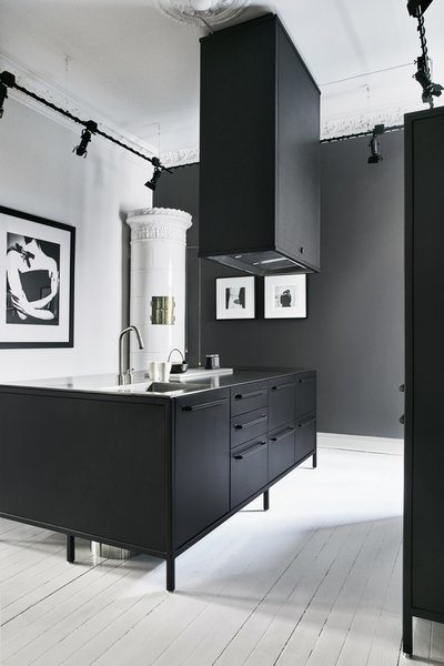 A modern, matte-black Vipp kitchen system in Gothenburg, Sweden.