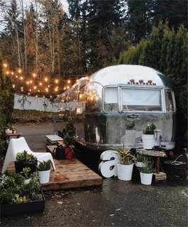 An ambitious couple's DIY overhaul of a decrepit 1971 Airstream Sovereign—purchased for less than $5,000—creates an airy retreat that feels much larger than its 200 square feet.