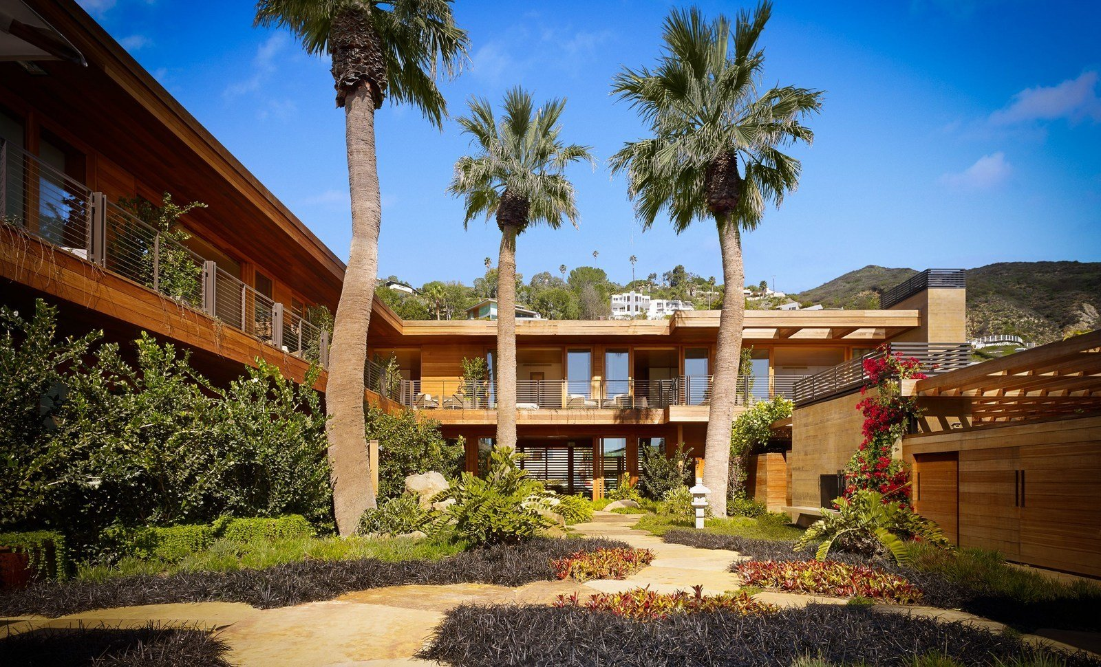 Outdoor, Garden, Shrubs, Gardens, Walkways, Trees, Landscape Lighting, Boulders, and Grass No two suites are the same, and the modernized rooms are artfully designed to incorporate Japanese elements, such as tatami mats and shoji screens.   Best Photos from A Former Beach Motel in Malibu Is Reborn as the Japanese-Inspired Nobu Ryokan