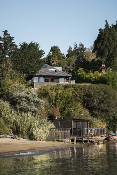 Built with a heavy timber post-and-beam structure, this renovated Tiburon kit house retains its standard footprint, framing, and tiled roof. Massive sliding glass doors were added to create an indoor/outdoor living experience.
