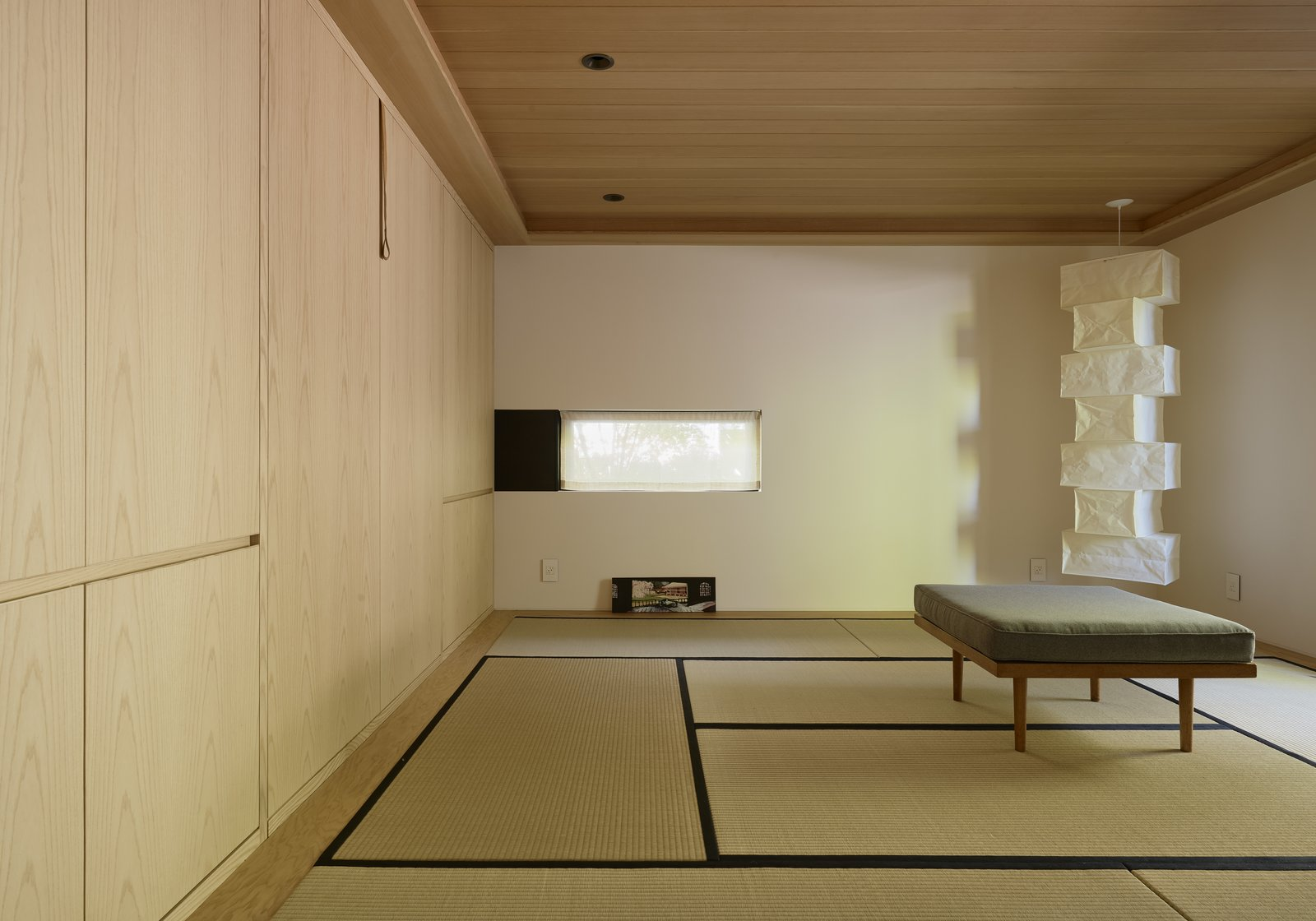 Shed & Studio and Sun Room Room Type The new interior includes a meditation room with an Isamu Noguchi lamp, flooring made of tatami mats, and a Murphy bed for visitors.  Photo 10 of 13 in You'd Never Guess This Japanese-Style Home in Tiburon Is a Kit House