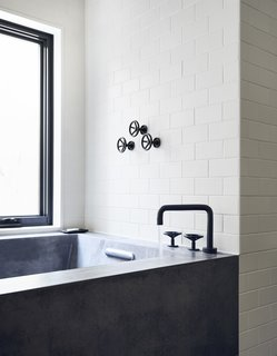 All of the home's plumbing fixtures are from Watermark Designs' Brooklyn 31 collection.