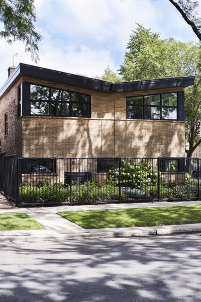 This 1954 split-level ranch on the Chicago's Near North Side was renovated, including raising the ceiling, converting the wood-paneled rec room and bar on the lower level into a master suite, and moving the kitchen into what had was a breezeway and part of the garage. When they discovered part of the original roof needed replacing, Delano referred to a butterfly design to suit the abode's midcentury lines.