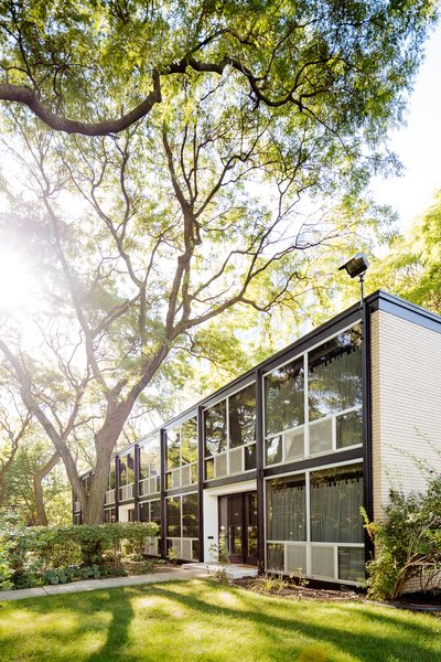 The couple's garden-style townhouse is one of nearly 200 units that Mies van der Rohe designed for Detroit's middle class after World War II. Zac Cruse Construction assisted with their remodel.