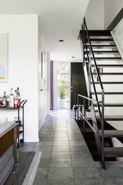 Bryan painted the metal band that runs around the top of each staircase Space Black by Benjamin Moore to match the treads.
