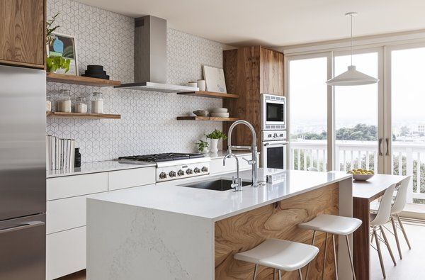 SVK Interior Design paired rich elm accents with matte-white laminate cabinets, gray-veined Caesarstone countertops, and show-stopping white Heath tile with dark grout.