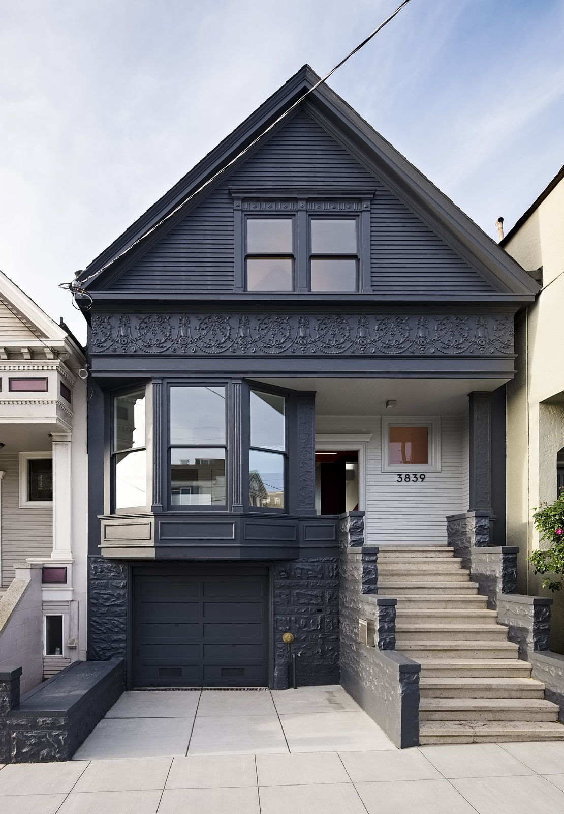 Exterior, Wood Siding Material, House Building Type, and Gable RoofLine The facade's historical details were preserved and painted Gunmetal by Benjamin Moore.  Photo 7 of 16 in After a Renovation, a Classic San Francisco Victorian Is Now Bursting With Light and Color