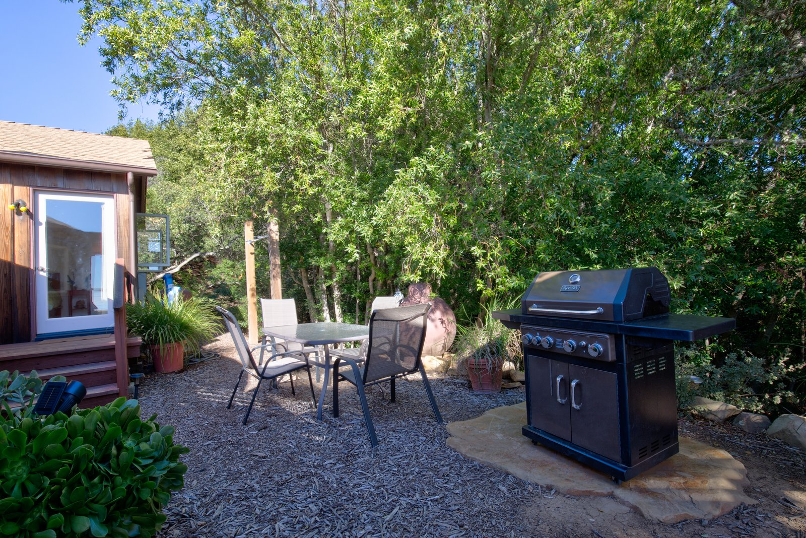 Outdoor, Back Yard, Trees, and Shrubs Warm, summer days and evenings call for a grill outside.  Photo 9 of 10 in This Santa Barbara Yurt Is the Ultimate Place to Recharge