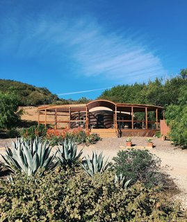 Adrian Larralde built the original yurt in 2010 and added the porch in mid-2017, extending the living space toward beach views.