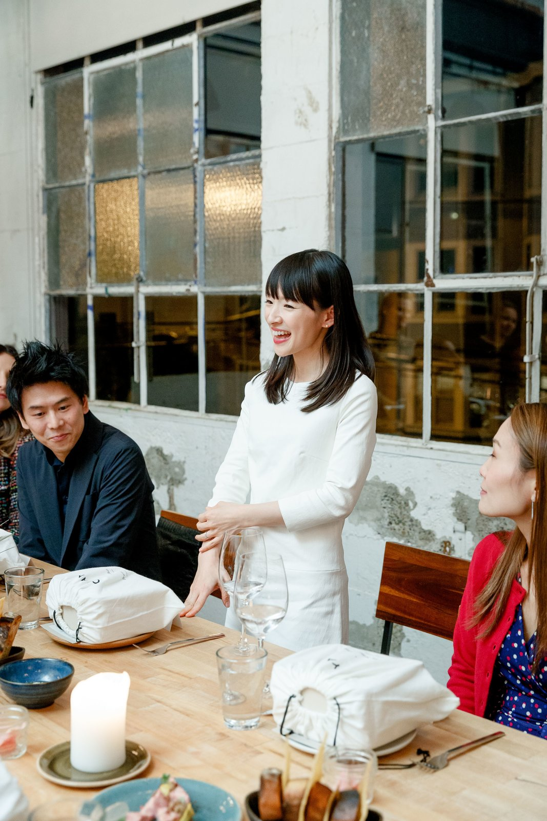 Dining Room, Table, and Chair Marie Kondo gives a speech at dinner with Cuyana and Dwell.  Photo 3 of 3 in 15 Chic Storage Bins to Spark Joy in Your Home from Watch: A Conversation With Decluttering Guru Marie Kondo
