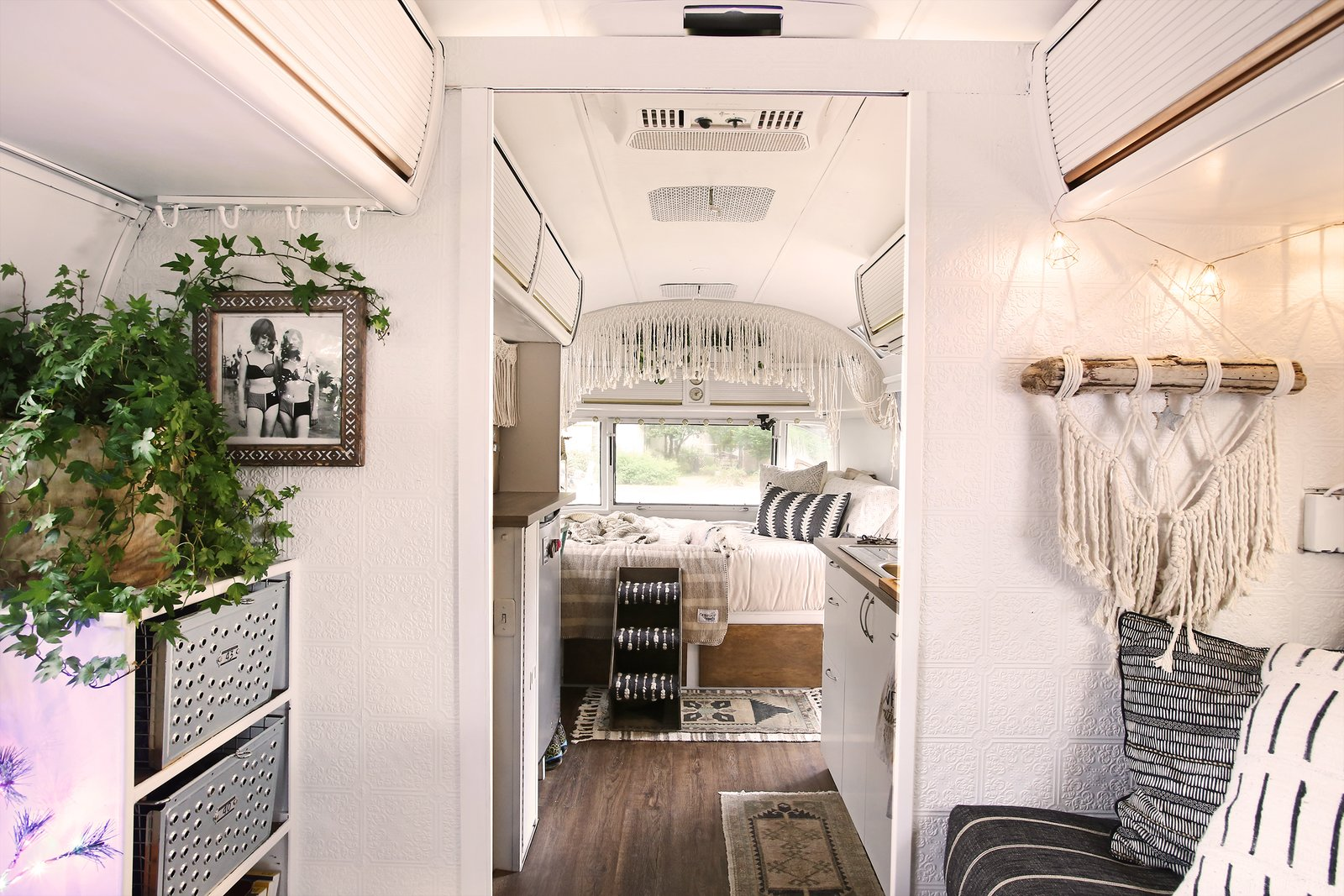 Living, Accent, Sofa, Rug, Dark Hardwood, and Storage To make the space feel larger, the couple opted for white walls and a minimal color palette.  Best Living Dark Hardwood Accent Photos from Before & After: A Couple Revamp an Old Airstream Into a Charming Workspace and Home