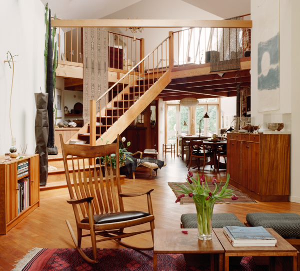 Living Room, Medium Hardwood Floor, Coffee Tables, Storage, and Chair Architect Albert Lanier transformed Kay Sekimachi and Bob Stockdale's Berkeley Victorian into a bright, open-plan residence that holds a treasure trove of work done by the couple and their friends. A small bedroom is tucked in the back of the upstairs aerie.  Photo 1 of 6 in Legendary Textile Artist Kay Sekimachi's Renovated Berkeley Victorian Is a True Creative Haven