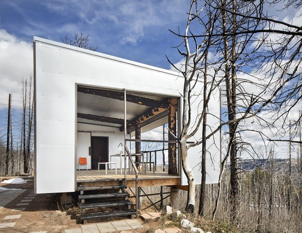 Except for a few chairs and a wood stove, there isn't much to Eric Logan's two-room cabin in the forest of Wyoming's Casper Mountain. After the original antiques-filled family cabin was destroyed in a brush fire, Logan, principal at Carney Logan Burke Architects, built this minimalist iteration to reinforce the importance of one's relationship with nature, magnified by the post-and-beam structure comprised of charred trees.