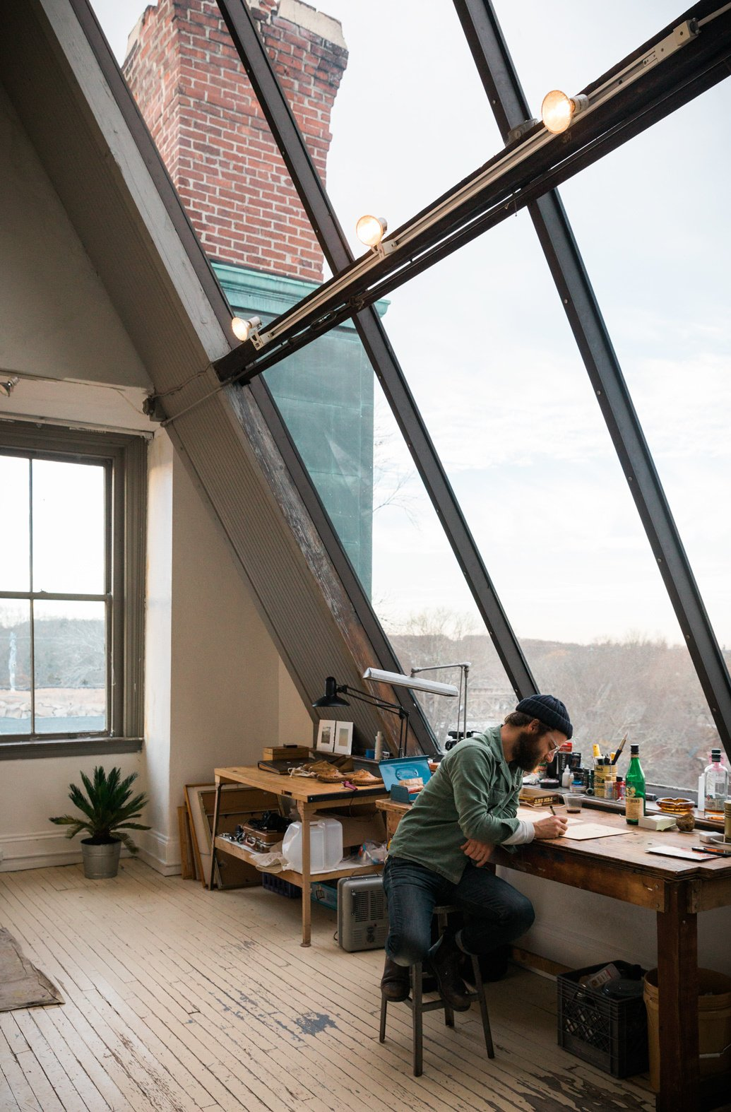 Office, Lamps, Chair, Painted Wood Floor, Craft Room Room Type, and Desk When asked what's next in the works, Spellman describes how he's working on an upcoming music festival and concert series called Westerly Sound.  Photo 10 of 10 in This Stunning Studio in Rhode Island Is a Creative's Dream