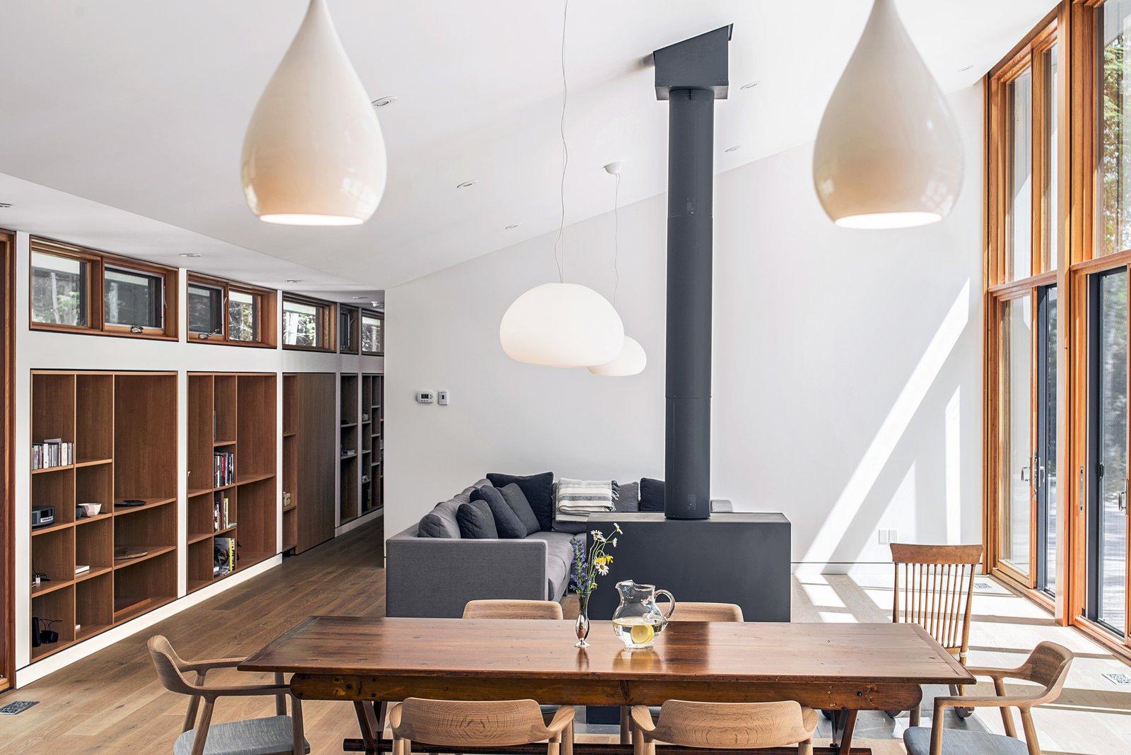 Dining Room Recessed Lighting Table Pendant Shelves Medium Hardwood Floor