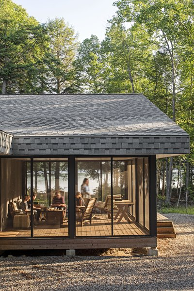 The cottage stretches for more than 110 feet, with a Muskoka room, or screened-in porch, at the northwestern end.