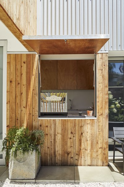 <b>Coffee Kiosk:</b> Accessible through a sliding millwork wall, the coffee kiosk doubles as a laundry room (the washer and dryer are hidden behind cabinets). A hatch window opens the space, which is outfitted with a refurbished 1997 Elektra espresso maker.