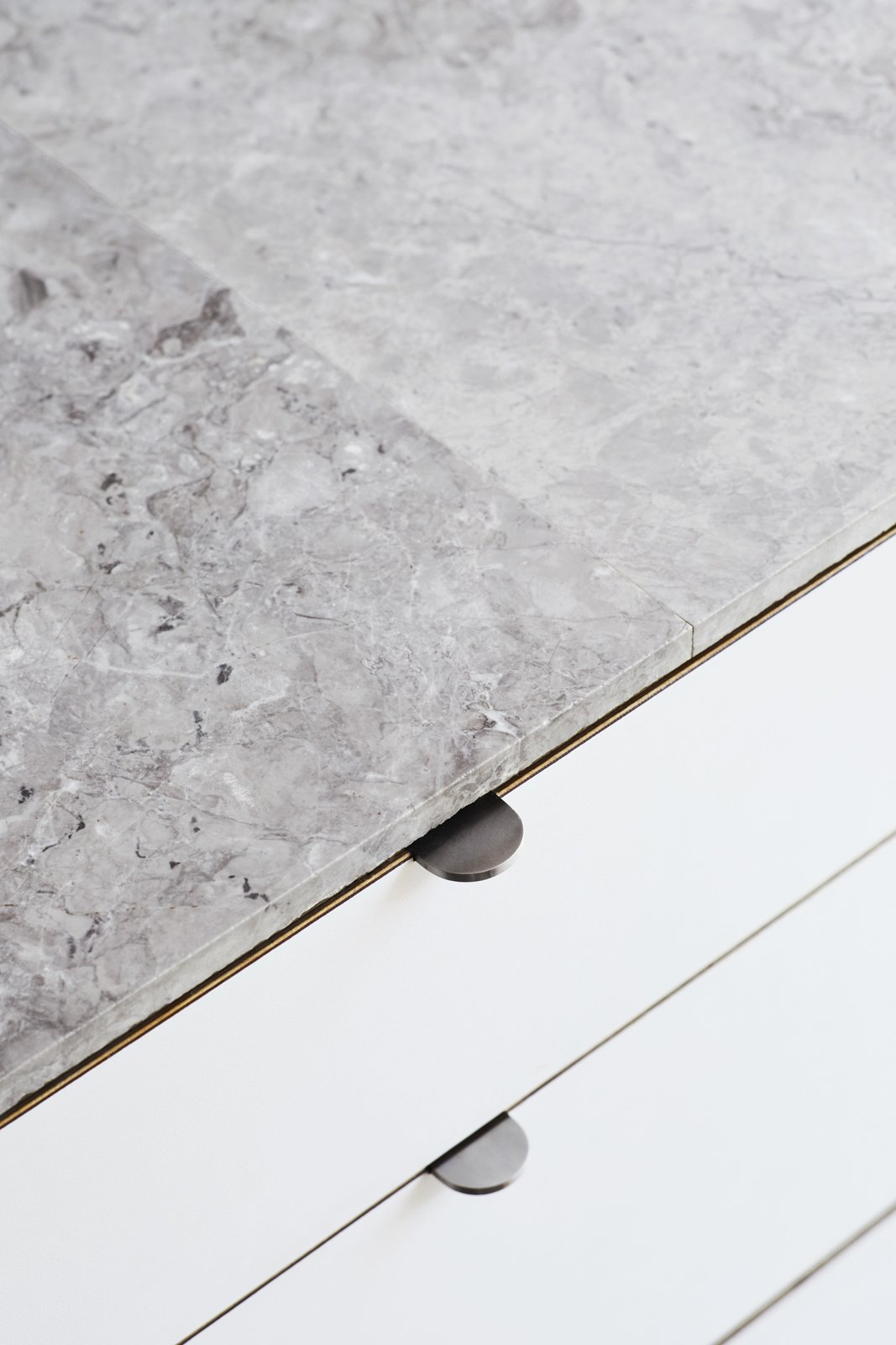 "<b>Kitchen Countertops: </b>The Jacks saved about $6,500 by skipping counter-sized marble  slabs and using one-by-two-foot marble tiles, sealed with silicone. ""The counters are thin and highly polished, but the sides have a rough texture,"" Beer observes.""></a></noindex></noindex></figure> <figure><noindex><noindex><a target="