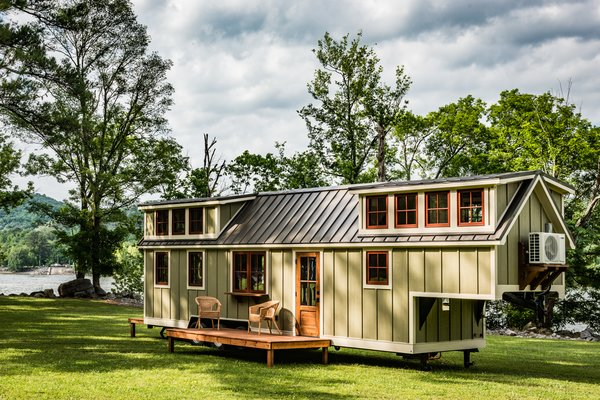 Based in Guntersville, Alabama, Timbercraft Tiny Homes promotes minimalism, deliberate and mindful living, and sustainability. Its five available models can be customized for individual needs and budget restraints. The Denali, pictured above, ranges from 37 to 41 feet long, and features a bedroom that can accommodate a king bed. Choose a bathtub or a tile shower for the bathroom, and enjoy a fully equipped kitchen with butcher block counters. The price runs from $94,000 to $104,000 for the standard model; additional options will cost upwards of $120,000.
