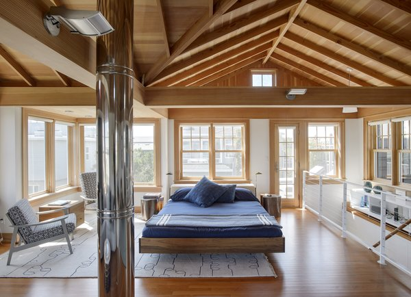 Michael Silber's beach bungalow on New York's Fire Island was built in 1939 by master carpenter Mike Coffey. When Silber added an upper level to the house in 2015, he sought tradespeople who could match Coffey's skill, choosing RJS Custom Carpentry.