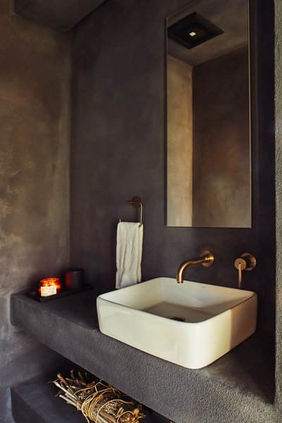 The washroom features a sink from Kraus and a faucet by Delta Faucet.