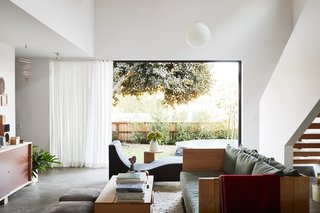 The Shinomotos have filled their Southern California home with furniture by Taku and pieces by some of the artists and craftspeople whose work they also showcase at their Tortoise shops and showroom. The couple worked with architectural designer Ken Tanaka to remodel the house, once a cramped, two-bedroom rental. A sofa and tables by Taku join Jasper Morrison's Three Sofa De Luxe sofa for Cappellini. The sliders are by Western Window Systems.