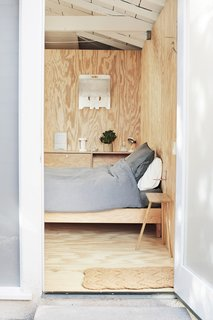 To make the most of a 900-square-foot home, Keiko and Takuhiro Shinomoto reworked an old garage into a guest room and clad the interior with unfinished plywood to match the home's modern and unfussy aesthetic.
