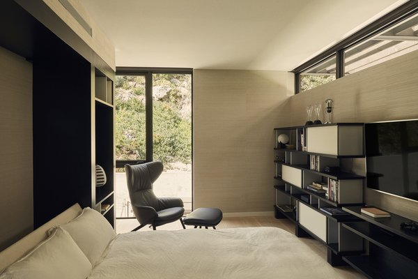 A Murphy bed transforms office into a guest room.