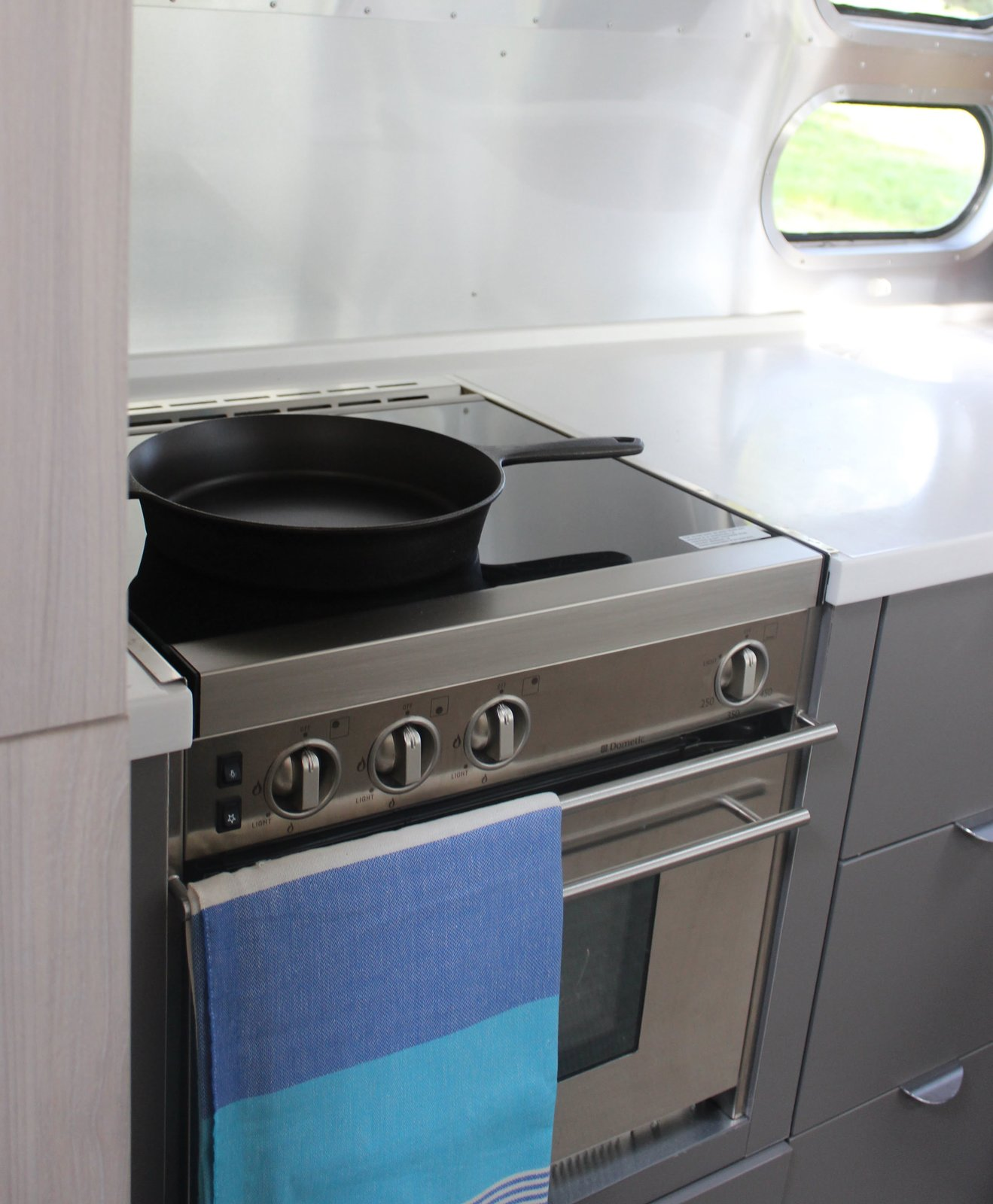 Kitchen, Wall Oven, and Cooktops The well-appointed kitchen features Corian surfaces, a Baraldi hood vent, and a glass cooktop. A slide-out pantry and a slide-out convection microwave make prepping meals a cinch.  Photo 9 of 17 in Bodega Bay or Bust: Taking the Airstream Globetrotter to Northern California's Coastal Gem